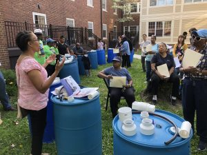 Residents learn how to construct rain barrels, conserve water