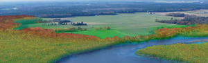 Screenshot from Jeff Allenby's powerpoint presentation showing a river and surrounding green land.