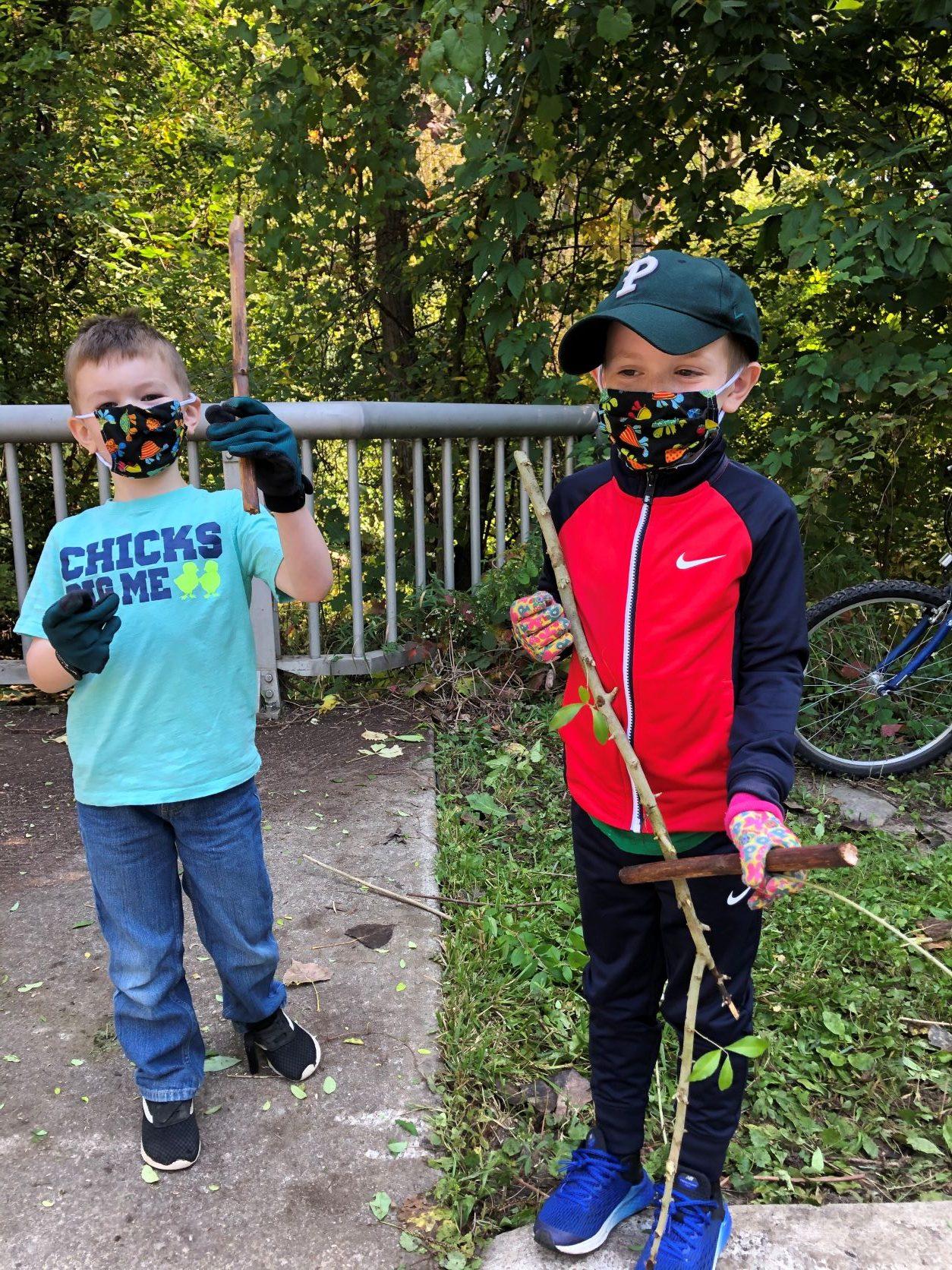 Two children help with restoration work.